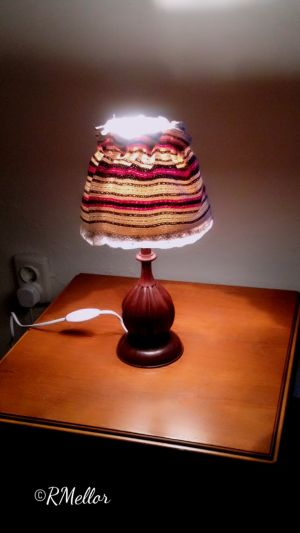 A lamp with a traditional shade.